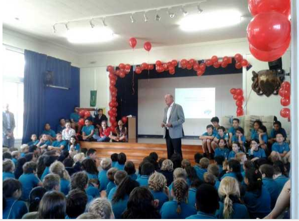 St Heliers club president, Don Craig addressed the Orakei School assembly before presenting a cheque for a playground upgrade.